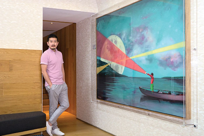 Wang Xiaobo posing with his art pieces, currently on display at The Repulse Bay Residence